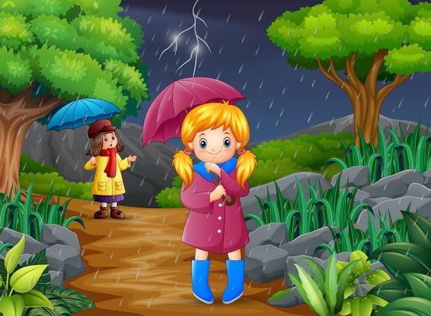 Beeldverhaal twee meisjes dragende paraplu