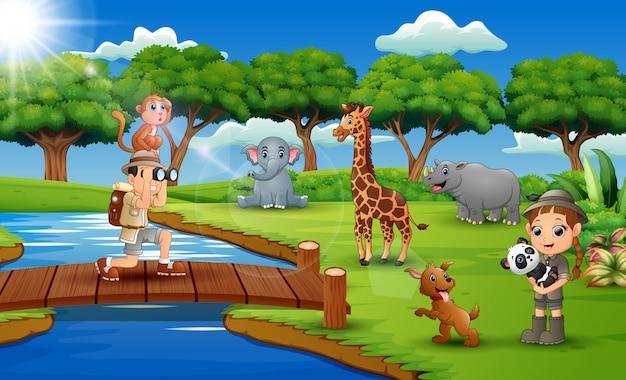 Beeldverhaal van zookeeper-jongen en meisje met dier in de wildernis
