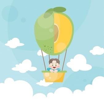 Beeldverhaaljonge geitjes die een mango van de heteluchtballon berijden