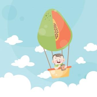 Beeldverhaaljonge geitjes die een papaja van de hete luchtballon berijden