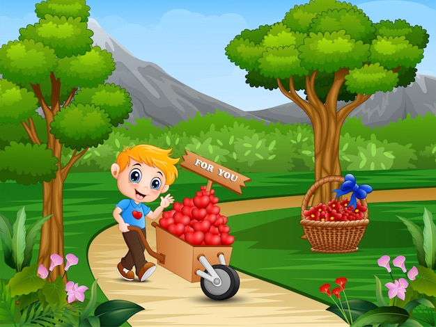 Beeldverhaaljongen die een stapel van harten in houten karretje op een parkweg duwen