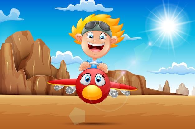 Beeldverhaaljongen die een vliegtuig in de woestijn vliegen