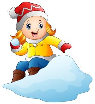 Beeldverhaalmeisje die snowboard met een sneeuw spelen