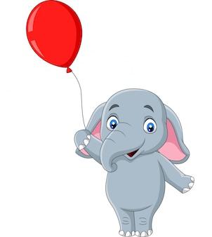 Beeldverhaalolifant die een rode ballon houdt