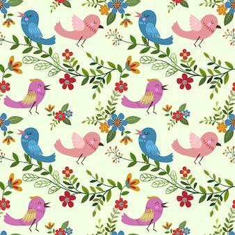 Beeldverhaalvogel met bloemen naadloos patroon.
