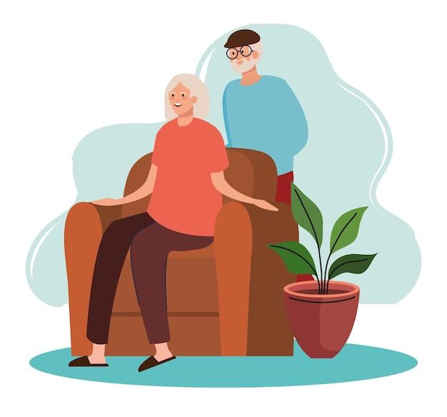 Bejaarde oude echtpaar gezeten in de woonkamer