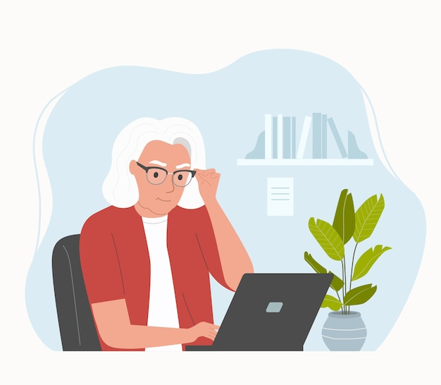 Bejaarde vrouw die op haar kantoor werkt.