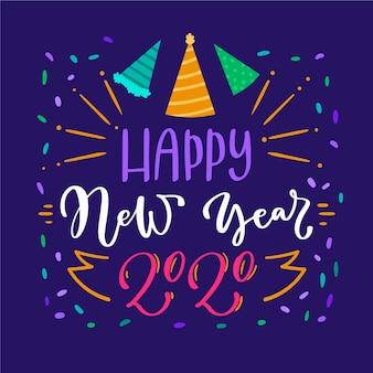 Belettering gelukkig nieuw jaar 2020 op blauwe achtergrond