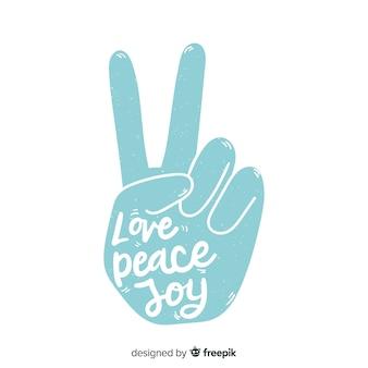 Belettering vredesteken hand