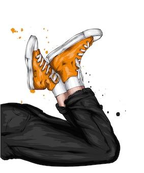 Benen in stijlvolle jeans en sneakers