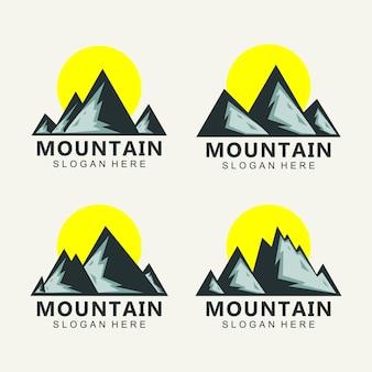 Berg logo ontwerp vector bij zonsondergang
