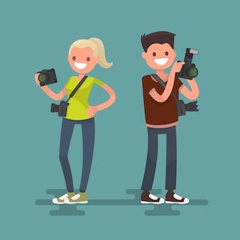 Beroepsfotograaf. man en vrouw met camera's