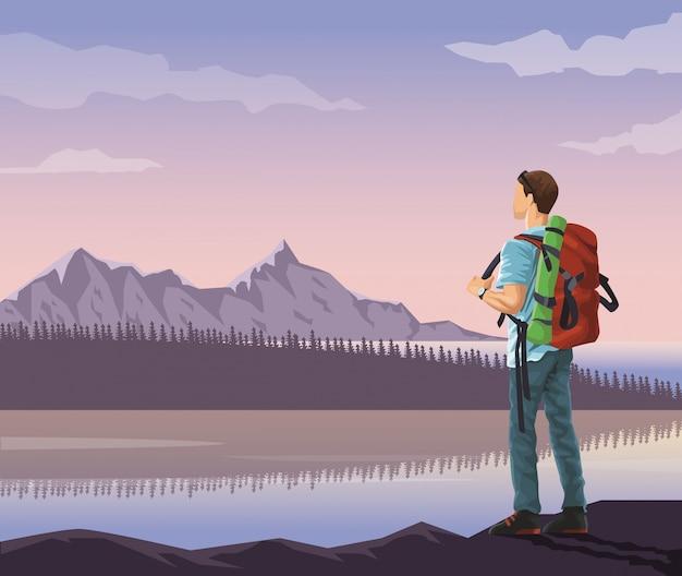 Besneeuwde bergen en meer met bergbeklimmer op zoek naar horizon