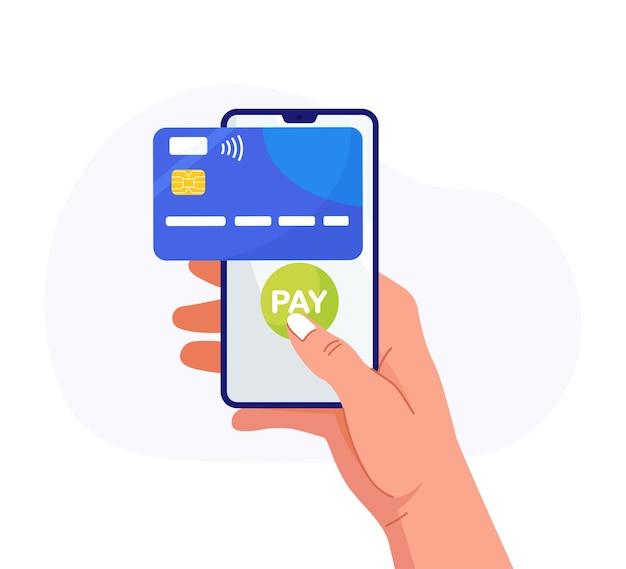 Betaal met creditcard via elektronische portemonnee op de telefoon. mobiel bankieren app, contactloos betalen. hand houdt smartphone met virtuele bankkaart. winkelen per telefoon en aangesloten creditcard, digitaal geld.