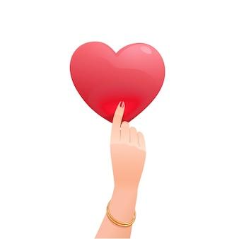 Bevallige vrouwelijke hand die het hart van een valentijnskaart rechtop houdt. rood romantisch symbool van liefde. geïsoleerde objecten op een witte achtergrond.