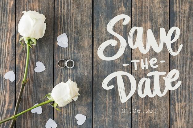Bewaar de datum belettering met foto van witte rozen