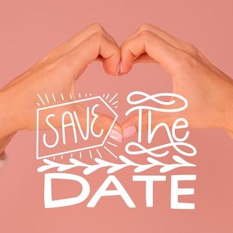 Bewaar de datum belettering met handen maken van hartvorm