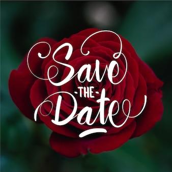 Bewaar de datum belettering op roos foto