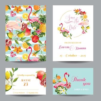 Bewaar de datumset trouwkaarten in bloemenachtergrond. tropische vruchten, bloemen en flamingovogels.
