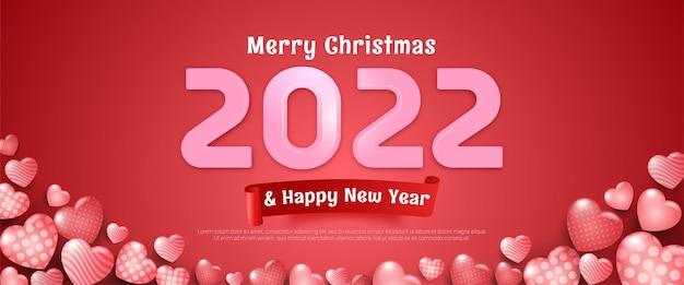 Bewerkbare tekst prettige kerstdagen en gelukkig nieuwjaar banner op roze achtergrond en enkele hartvormige ballonnen