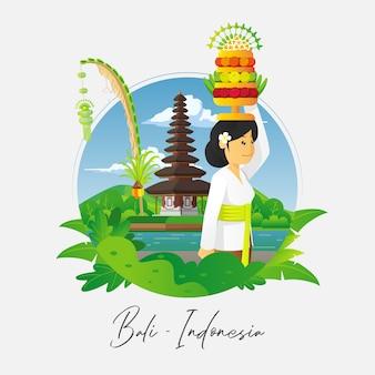 Biddende balinese vrouw met tempelachtergrond
