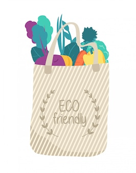 Biege eco tas met biologisch voedsel. verschillende groenten. herbruikbaar.