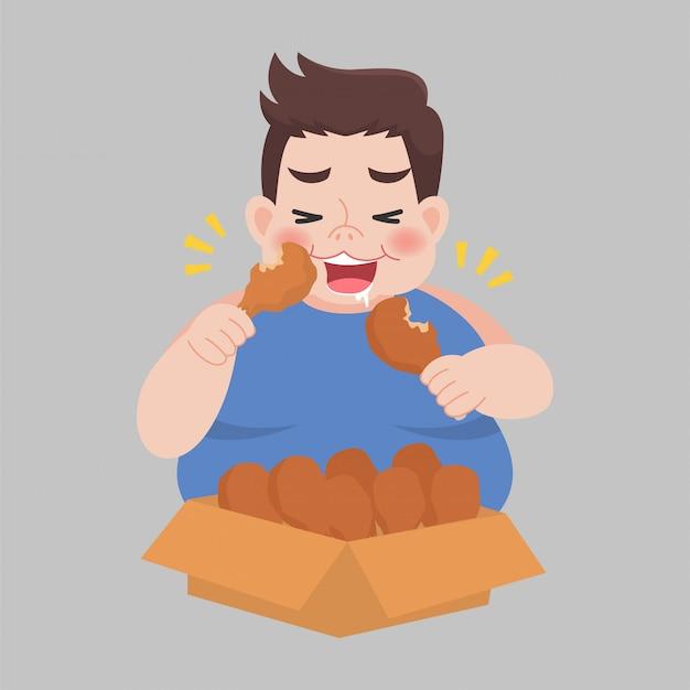 Big fat happy man geniet van het eten van kip drumstick