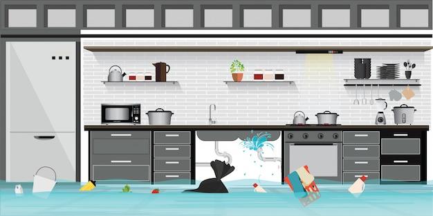 Binnenlandse overstroomde kelderverdiepingsvloer van keuken met lekke pijpleiding.