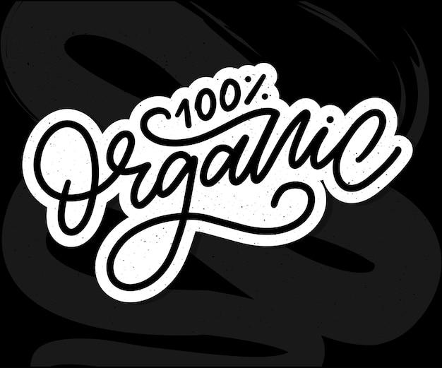 Biologische borstel belettering hand getrokken woord biologisch met groene bladeren label logo sjabloon voor biologische pr...