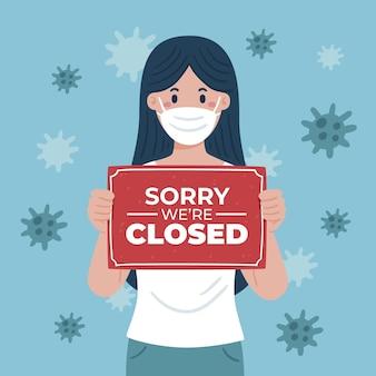 Biologische platte vrouw met een sorry we zijn gesloten uithangbord vanwege coronavirus