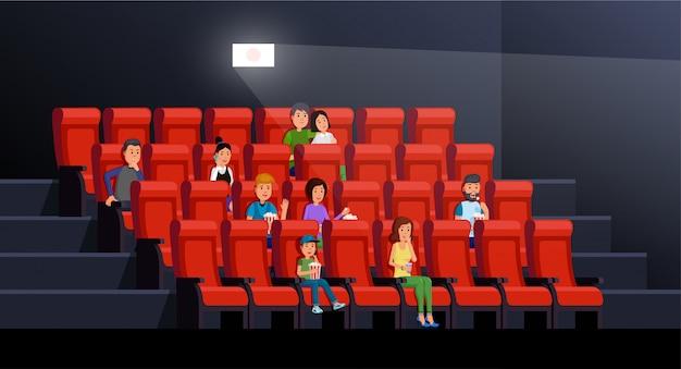 Bioskoopbinnenland met mensen die popcorn eten en van film in beeldpaleis genieten