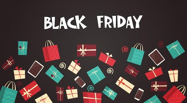 Black friday-tekst met verschillende geschenkdozen