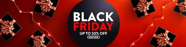 Black friday-uitverkoop 50% korting op poster met geschenkdoos en led-lichtslingers voor detailhandel