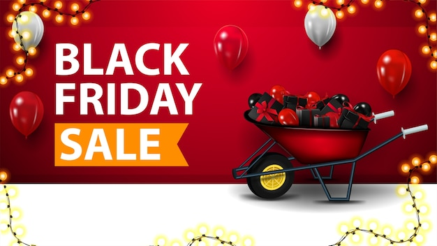 Black friday-uitverkoop, rode kortingsbanner met kruiwagen met cadeautjes voor zwarte vrijdag bij de muur, ballonnen in de lucht en slingerframe