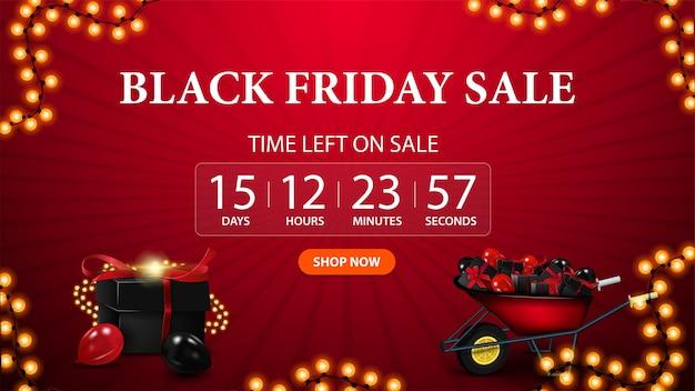 Black friday-uitverkoop, rode kortingsbanner voor website met afteltimer tot het einde van de actie, knop, slinger, cadeautjesdoos en kruiwagen met cadeautjes