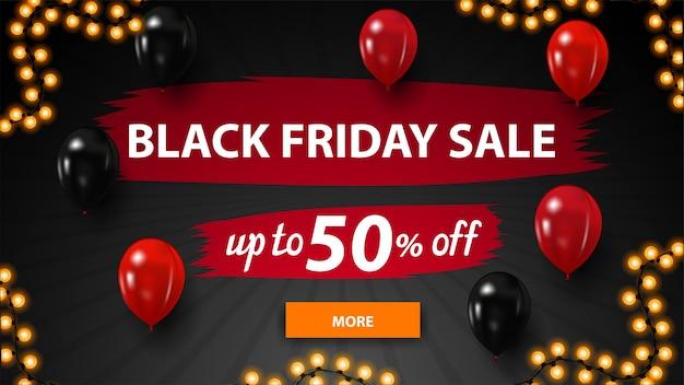 Black friday-uitverkoop, zwarte kortingsbanner met groot aanbod, penseelstreken van de kunstenaar, rode en zwarte ballonnen, knop en slingerframe
