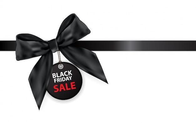Black friday-verkoop labei met boog en lint op wit wordt geïsoleerd dat