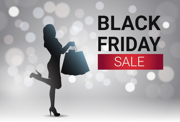 Black friday-verkoopbannerontwerp met silhouetwijfje over witte lichten bokeh achtergrondvakantie