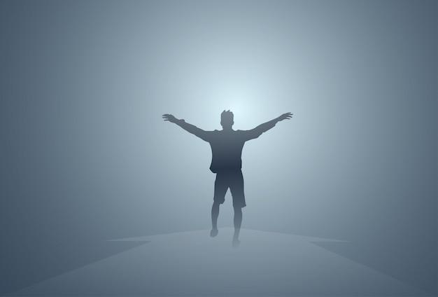 Black silhouette man cheerful raised hands full length isolated gelukkige kerel