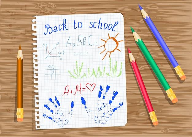 Blad van oefenboek en kleurpotloden.