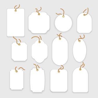 Blanco witte papieren prijskaartjes of cadeaukaartjes in verschillende vormen set etiketten met koord