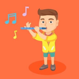 Blanke kleine jongen die de fluit speelt.