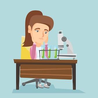 Blanke student werkt in laboratoriumklasse.