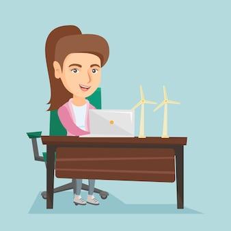 Blanke werknemer van windpark werkt op een laptop.