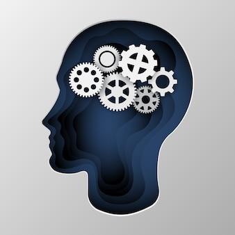 Blauw silhouet van het hoofd van een man op papier gesneden.