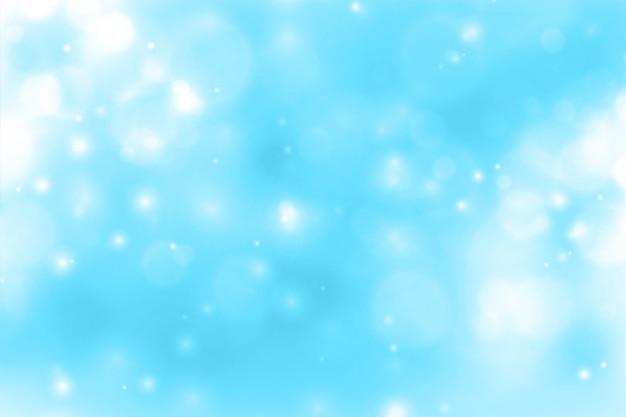 Blauwe achtergrond met gloeiende fonkeling bokeh