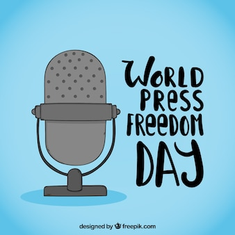 Blauwe achtergrond met microfoon voor de dag van de persvrijheid