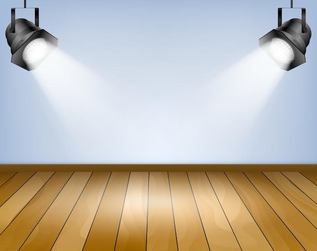 Blauwe achtergrond met schijnwerpers. studio met houten vloer