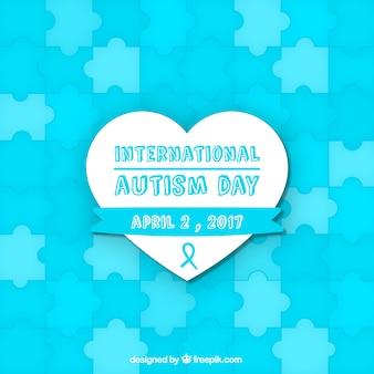 Blauwe achtergrond van autisme dag met puzzelstukjes