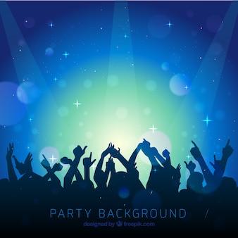 Blauwe achtergrond van de mensen bij een concert
